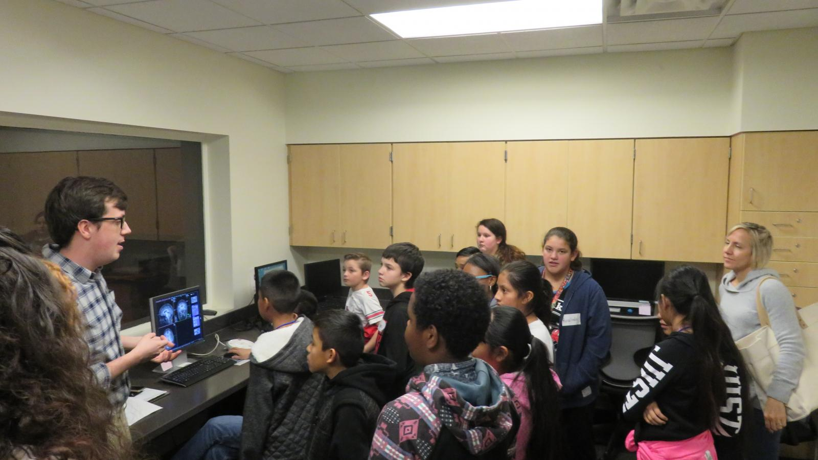 Members of the CCBBI Student Group lead Hilltonia 6th graders on a tour of the fMRI suite.