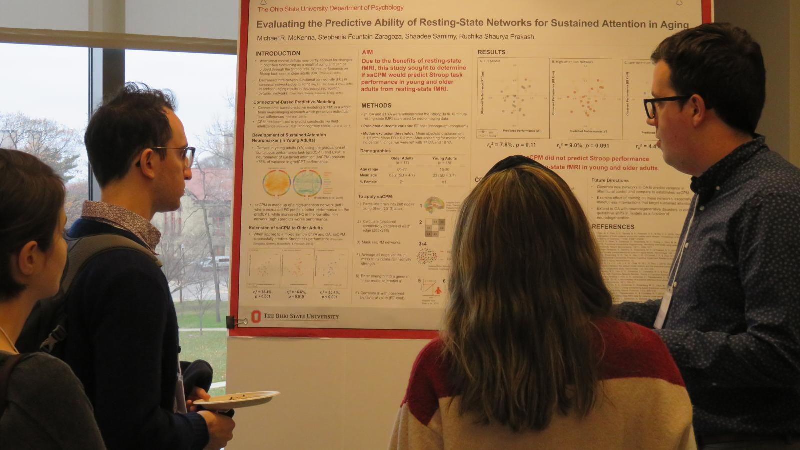 Graduate Student Mike McKenna presents his research poster